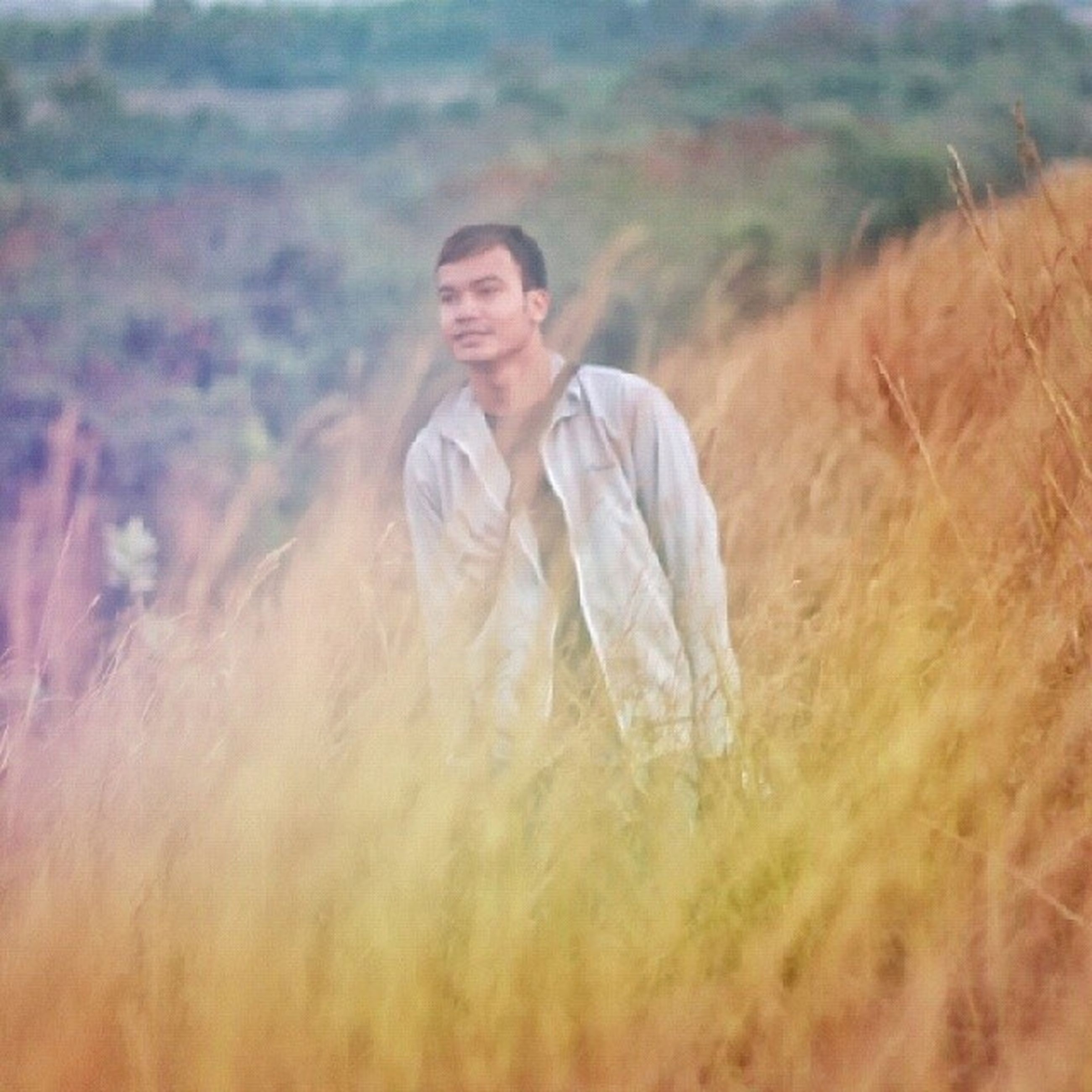 person, lifestyles, leisure activity, casual clothing, waist up, portrait, looking at camera, front view, three quarter length, focus on foreground, standing, young adult, nature, smiling, field, outdoors, childhood, selective focus