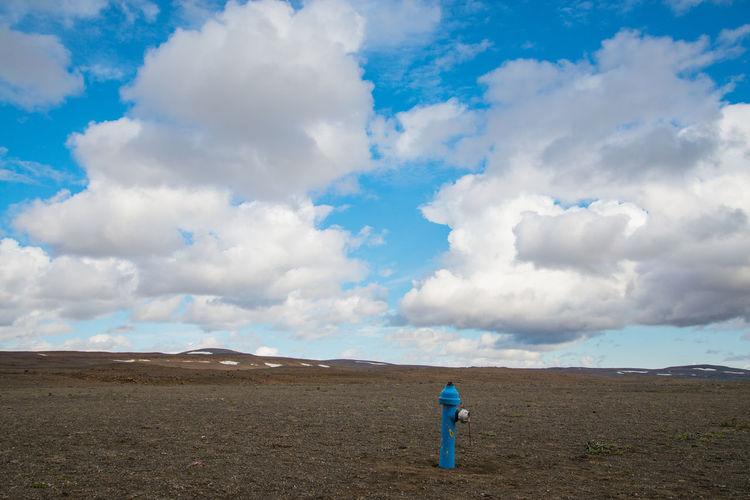 Water pump on field against sky