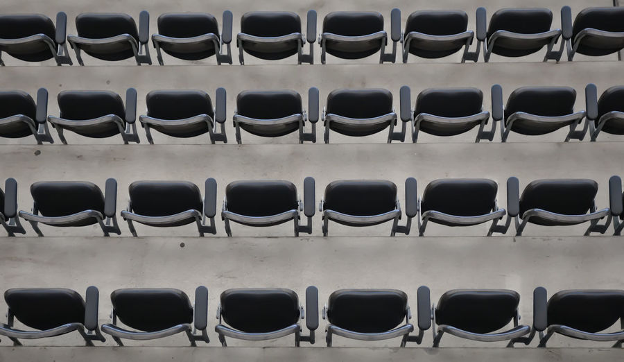 take a seat Urban Empty Bench Order Repetition Stadium Arrangement Pattern Seat Stadion Leer Side By Side No People Sitzreihe Abundance Part Of In A Row Large Group Of Objects Seating Bench Full Frame Backgrounds Indoors  Day Krull&Krull Architecture