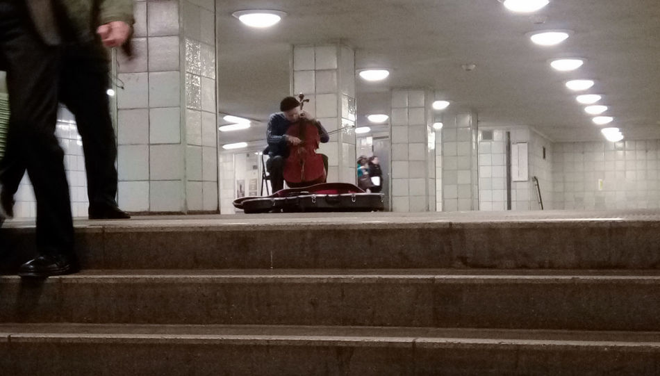 Adult Musician People Adults Only Full Length Men Indoors  Illuminated Young Adult Playing Music Real People Performance Sitting Taking Photo Trainstation By Night Simple Things In Life Urban Lifestyle Cello U-Bahn Berlin Streetmusicians Cold Night Musical Instrument Day One Person