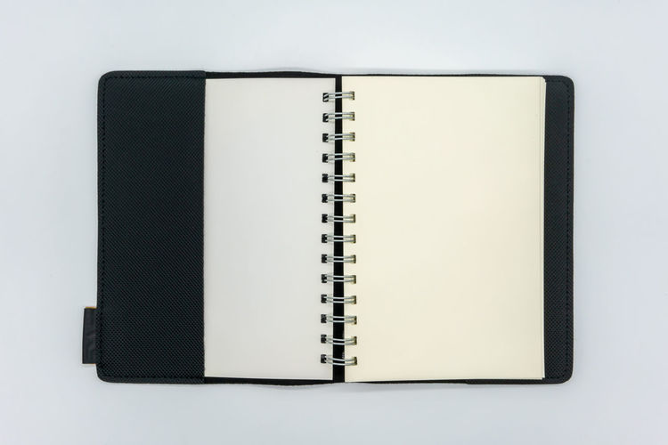 Directly above shot of book against white background