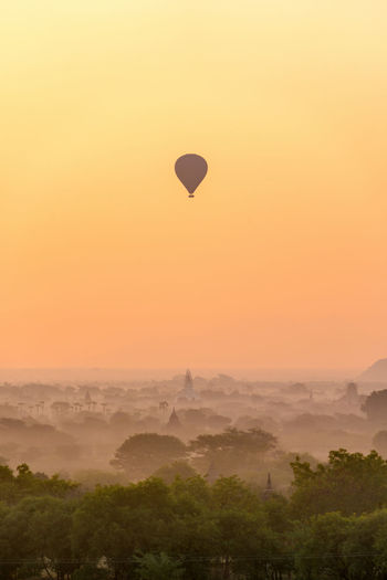 Hot air balloon against sky at sunset