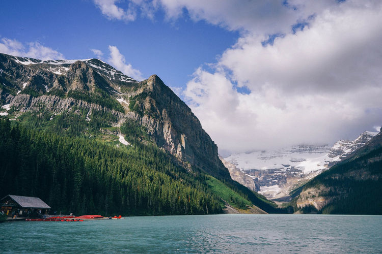 Lake Louise, Canada Mountain Sky Water Scenics - Nature Beauty In Nature Mountain Range Tranquil Scene Tranquility Nature Non-urban Scene Day Lake No People Outdoors Formation Canada Banff National Park  Bare Tree Alberta Terquoiseblue Blue Lagoon Blue Lake
