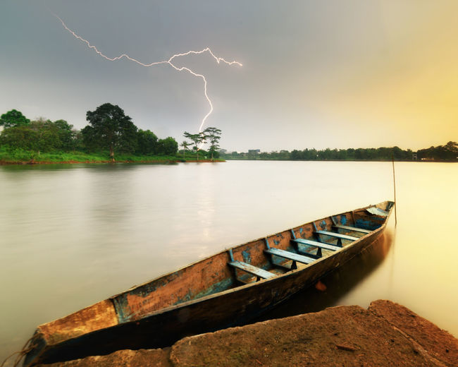 Lightning Boat Water Sky Cloud - Sky Beauty In Nature Nature Tree River Plant Lightning Power In Nature No People Reflection Scenics - Nature Transportation Nautical Vessel Outdoors Storm Storm Weather Lake Thunderstorm Travel Destinations Boat Jakarta INDONESIA Sunset Rain Leading Lines The Great Outdoors - 2019 EyeEm Awards