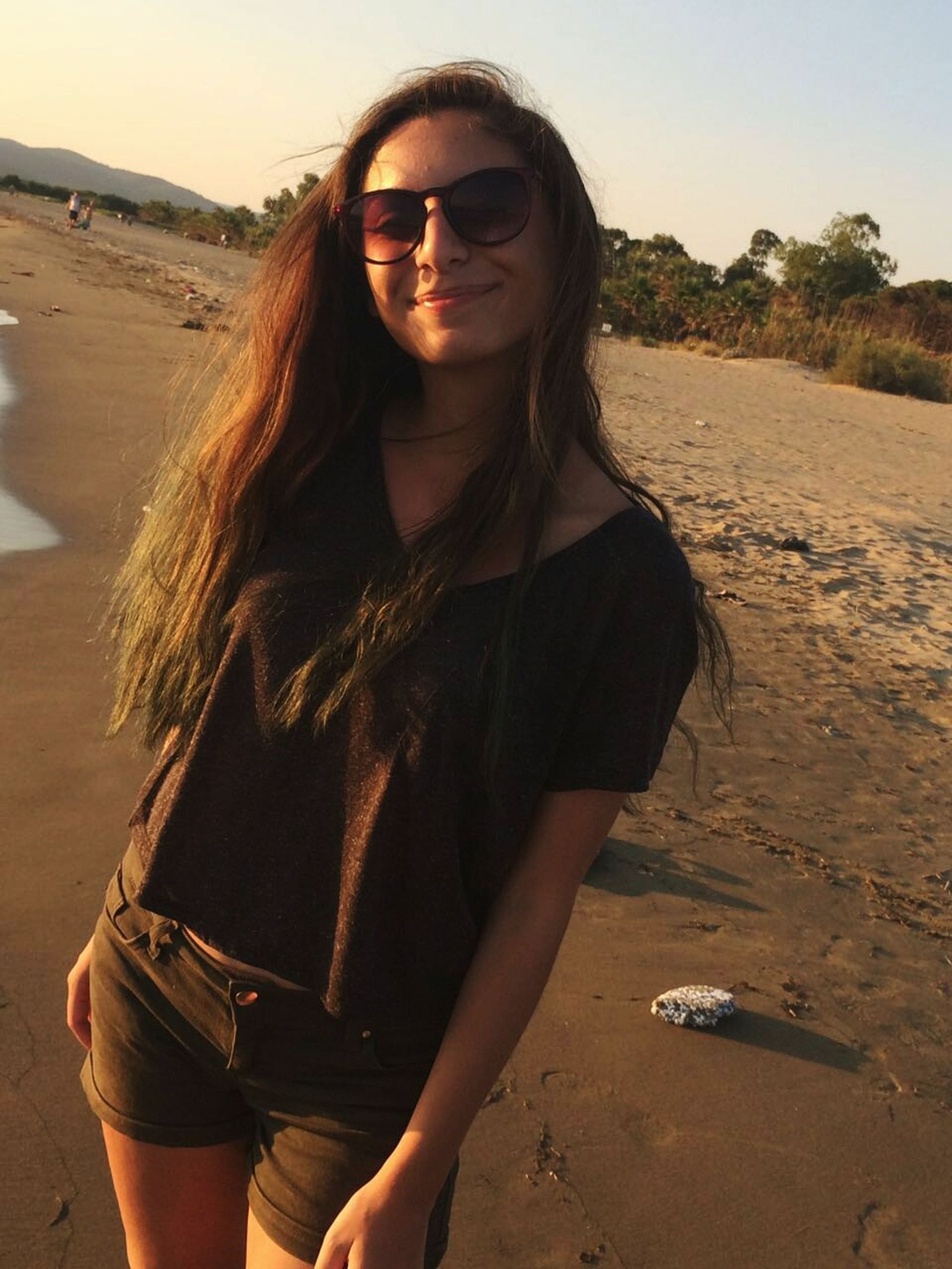 sunglasses, young adult, long hair, portrait, beach, fashion, one person, one woman only, beautiful woman, adult, young women, beauty, adults only, happiness, sunset, sand, people, smiling, one young woman only, outdoors, only women, nature, day