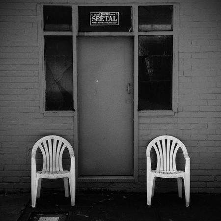 Outdoor Chairs outside factory in Summer Hill, in Sydney , in Black And White using Procamera app and VSCOcam app, with an iPhone 5 camera.