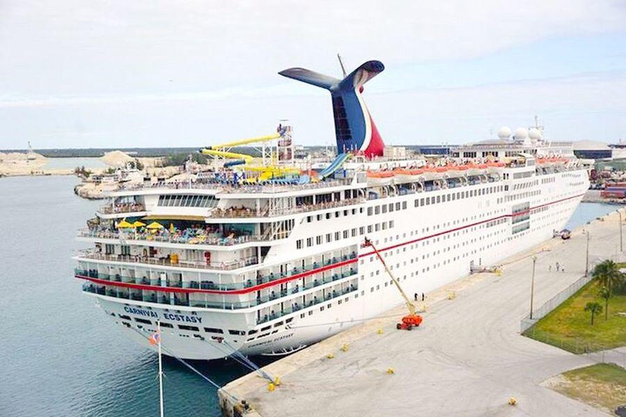 Carnivalesctasy docked in port alongside in Freeport Bahamas Cruise Ship Cruiseship Cruise Ships Cruise FotosDeSWAO Carnivalcruiseline #FotosDeSWAO