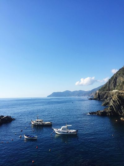 Boat Riomaggiore Water Nautical Vessel Sky Sea Transportation Mode Of Transportation Copy Space Nature Clear Sky Blue Mountain Waterfront Scenics - Nature Beauty In Nature Travel