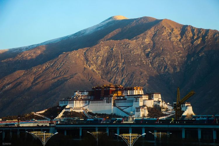 View of buildings and mountain against sky