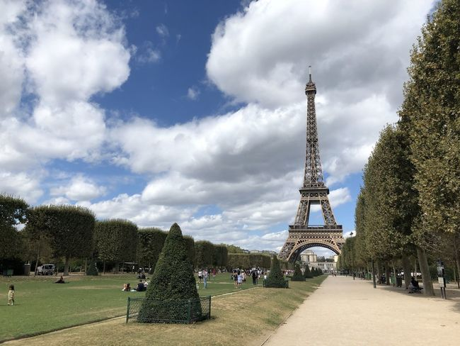 Eifel Tower Eiffel Tower Architecture Built Structure City Cloud - Sky Day Grass Hedge History Nature Outdoors Park Plant Sky Spire  Tall - High The Past Tourism Tower Travel Travel Destinations Tree Treelined