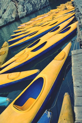 canoes Canoes On Lake Yellow Blue Water EyeEm Gallery Many In A Row Beauty In Ordinary Things
