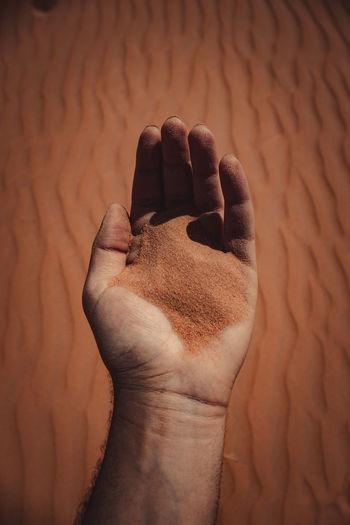 High angle view of human hand on wall