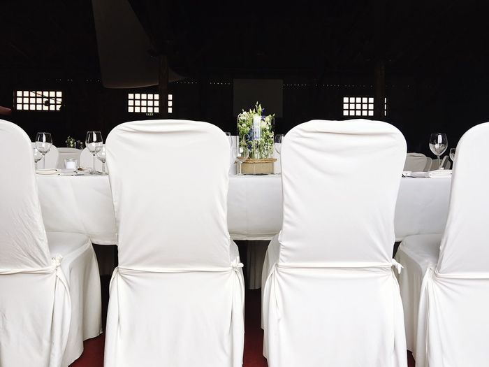 Chairs And Table Arranged At Wedding Reception