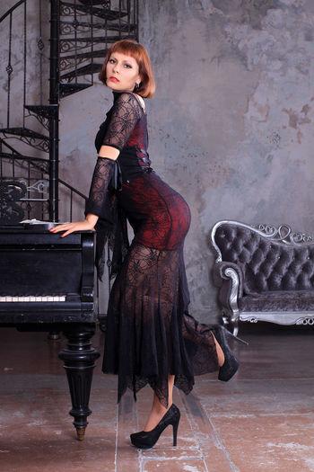 Full length portrait of woman standing