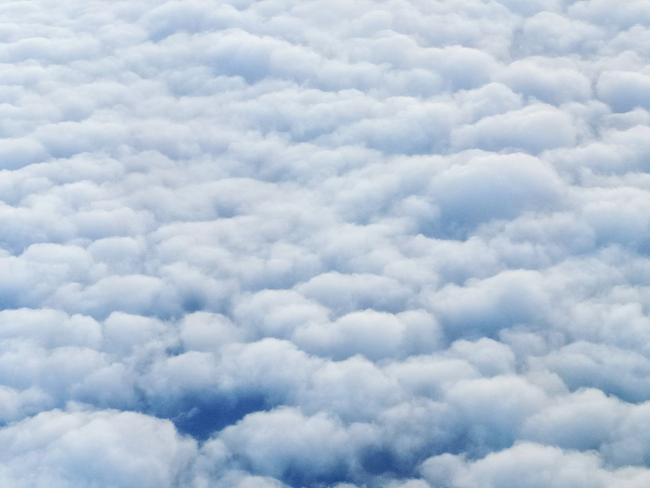 cloud - sky, backgrounds, nature, beauty in nature, cloudscape, white color, softness, sky, sky only, atmospheric mood, tranquility, weather, scenics, heaven, no people, full frame, low angle view, day, outdoors, blue