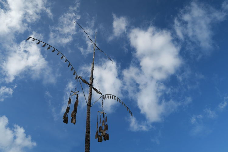 The Lucy pole that is believed to bring luck to villagers who live under the protection of this pole Beauty In Nature Blue Cloud - Sky Day Low Angle View Nature No People Outdoors Sky