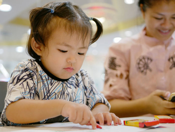 Little Asian baby girl learning to grasp a crayon and do painting by herself Baby Girl Asian  Learn Little Young Grasp Hold Crayon Crayons Sit Drawing Coloring Painting Child Kid Toddler  Asian  Ignored Ignorance Mother Addicted Addiction Smartphone Attention