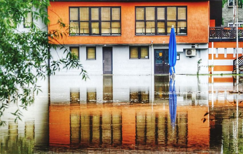 Building Exterior Built Structure Architecture Water Wet Reflection Window Rain Accidents And Disasters Outdoors Flood Residential Building Waterfront No People Rainy Season City Natural Disaster Day Reflection