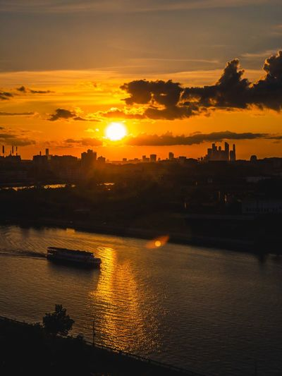 Moscow sunset Moscow Sunset Water Sky Orange Color Beauty In Nature Scenics - Nature Silhouette Outdoors River Idyllic Tranquility Cloud - Sky Tranquil Scene Nature No People Reflection Sun Sunlight