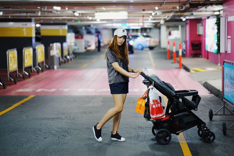 Full Length Adult People Adults Only Only Women One Person One Woman Only Indoors  Women Lifestyles Luggage Day Young Adult City Shopping Mall Parking Fashionstyle Street Road Gap Stroller Pose