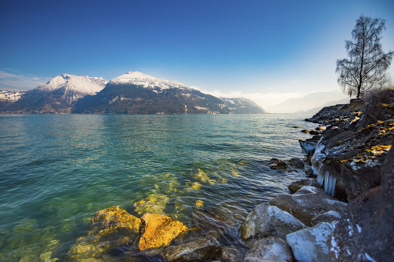 Ice Thun Beauty In Nature Blue Clear Water Day Idyllic Land Mountain Mountain Range Nature No People Non-urban Scene Outdoors Rock Rock - Object Scenics - Nature Sea Sky Snowcapped Mountain Solid Tranquil Scene Tranquility Water