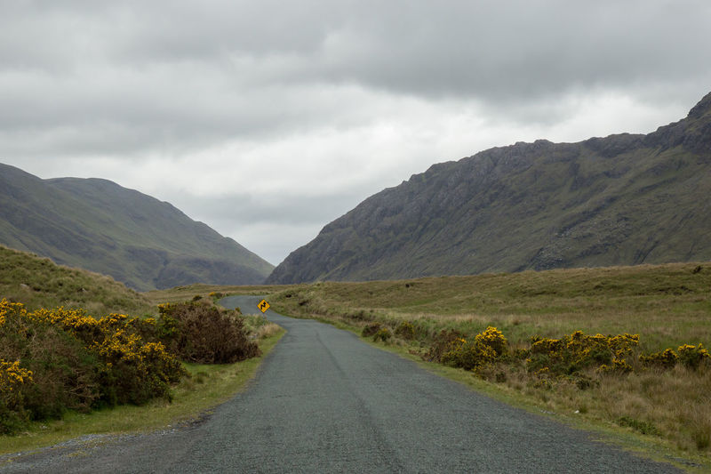 winding road on a cloudy day Beauty In Nature Cloud - Sky Connemara Day Destination Highway Ireland Landscape Mountain No People Outdoors Road Storm Cloud Travel Winding Road
