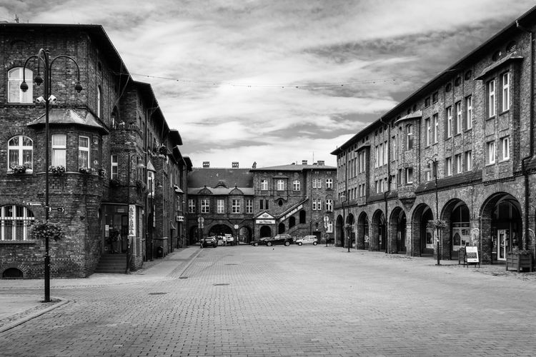 Nikiszowiec. 2017 - #07. Street Architecture Black And White Street Photography Building Historic High Contrast Street Lights Cobblestone Historic Building EyeEm Best Shots Silesia Nikiszowiec Cloud - Sky Building Exterior Residential District EyeEm Selects