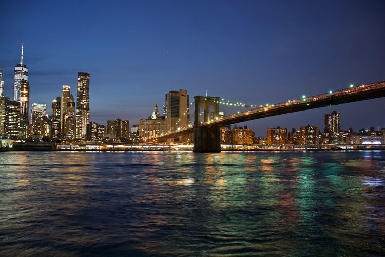 Illuminated Cityscape By East River At Night