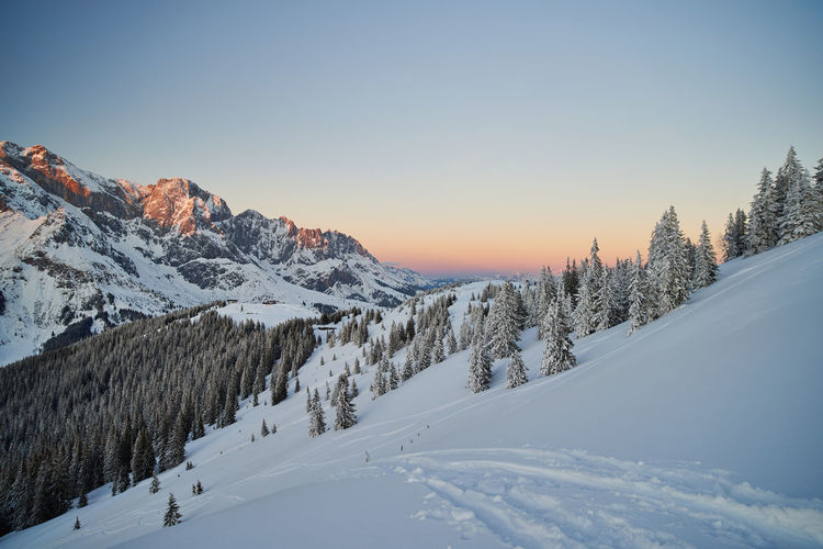 Sunset in the snowy alps in pastellic colors