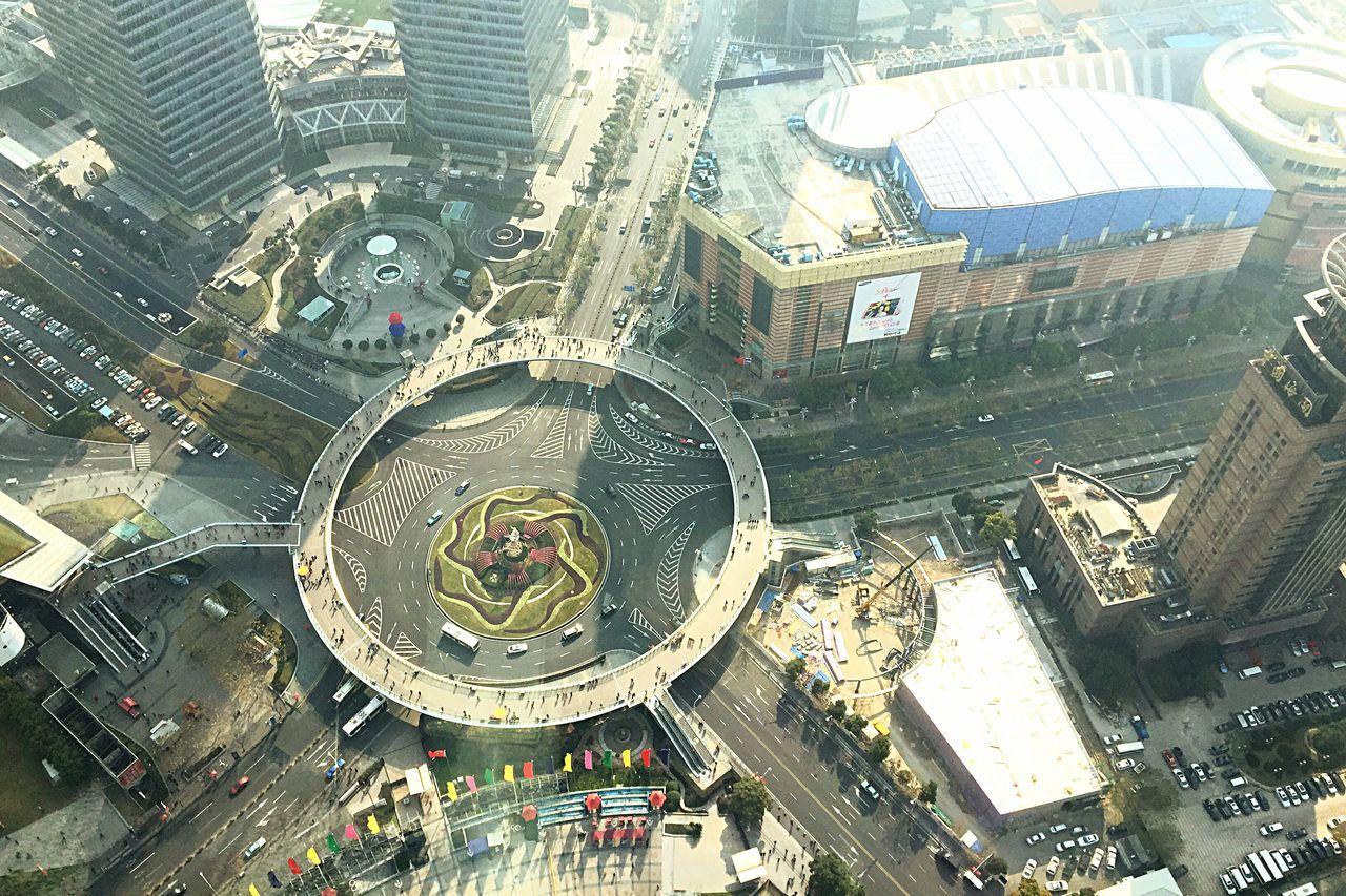 High angle view of circular bridge amidst city
