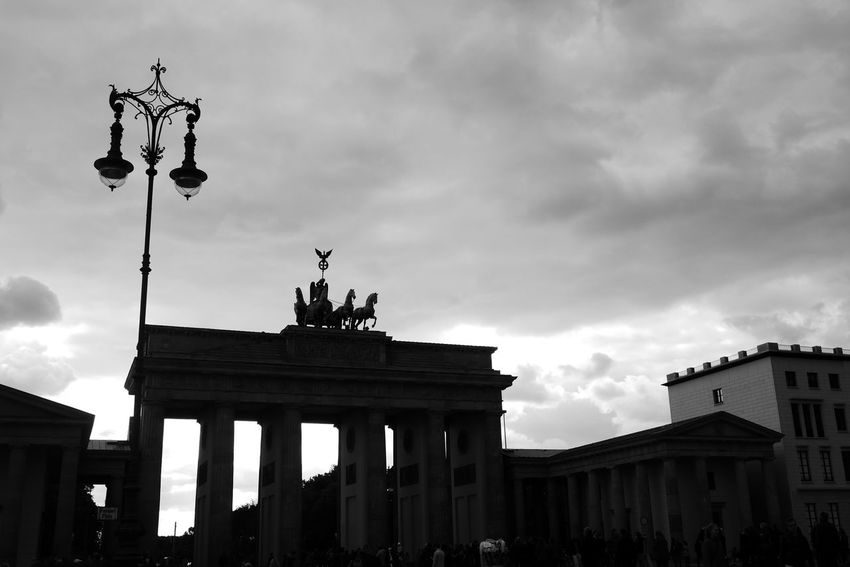Capture Berlin Sky Cloud - Sky Architecture Low Angle View Building Exterior Statue Travel Destinations City Gate Architectural Column Outdoors Sculpture Large Group Of People Day Tree