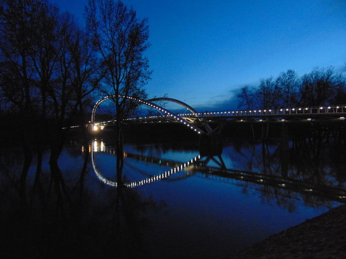 Bridge over river at night
