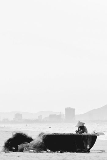 Vietnam ASIA Ocean Beach Black And White The White Album Fisherman Boat On A Boat Fixing Fishernet Hands At Work Traveling Travel Showcase April The Great Outdoors With Adobe The Photojournalist - 2016 EyeEm Awards People Of The Oceans Black And White Friday