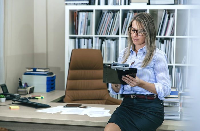 Portrait of blonde woman writing notes sitting over her desktop table Blonde Business Busy Chair Company Desktop Folders Hard Horizontal Office Receptionist Woman Working Writing Assistant Beauty Business Finance And Industry Businesswoman Female Notes One Person Phone Secretary Smart Phone Stressed