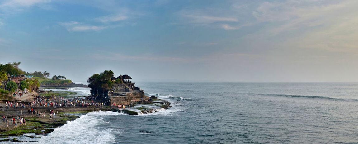 Tanah Lot in broad daylight Traveling Bali Beach Panorama