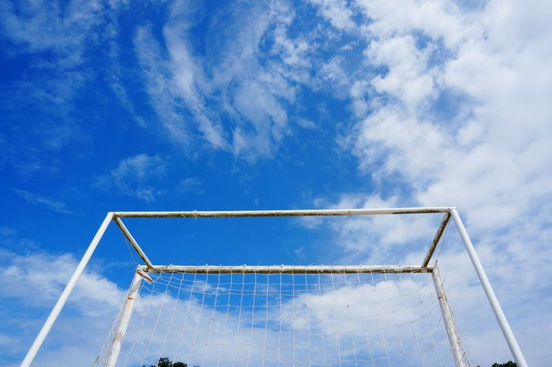 Low angle view of soccer goal against sky