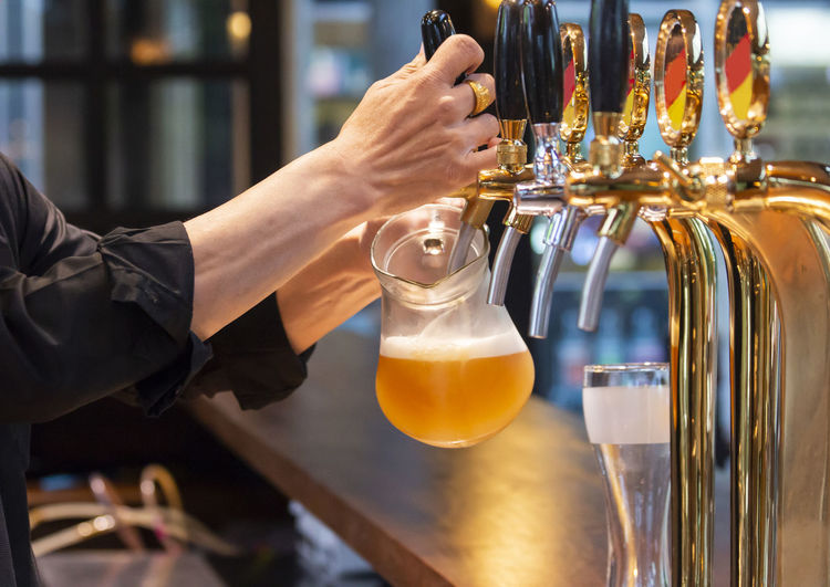 Pouring beer Alcohol Bar - Drink Establishment Bar Counter Bartender Beer Beer - Alcohol Beer Glass Beer Tap Bottle Craft Beer Drink Drinking Glass Focus On Foreground Food And Drink Glass Glass - Material Hand Holding Human Body Part Human Hand Indoors  Real People Refreshment