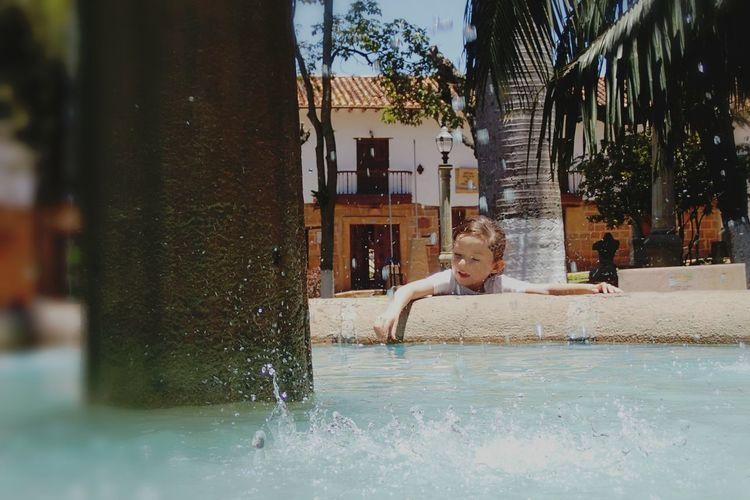 Portrait of shirtless man in swimming pool