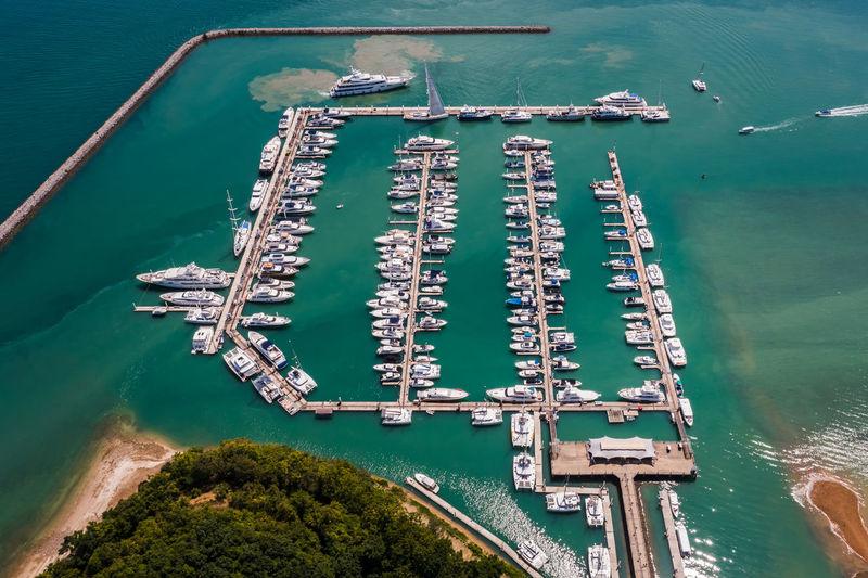 Yachts and boats in marina bay at phuket thailand aerial view