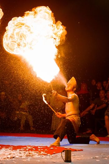 Fire-eater performing at night