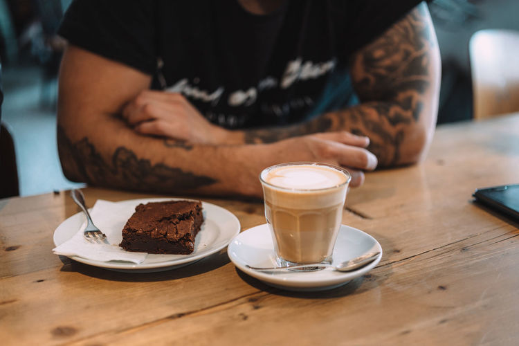 Coffee and Tattoos Berlin Berlinstagram Brownie Cafe Cake Coffee Coffee Break Coffee Time Food And Drink Midsection One Person Sweet Food Table Tattoo Tattooed Tattoos Temptation Capture Berlin