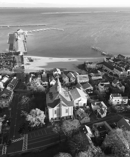 View from 77 meter high Pilgrim Monument Sea High Angle View Architecture Building Exterior Horizon Over Water Built Structure Water Outdoors Day No People Nature Sky Tree City Provincetown