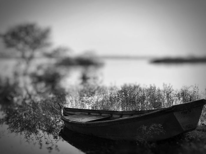Nautical Vessel Water Boat Transportation Moored Nature Mode Of Transport No People Tranquil Scene Tranquility Focus On Foreground Outdoors Day Lake Beauty In Nature Abandoned Rowboat Sky Scenics Clear Sky IPhone7Plus India Narkher