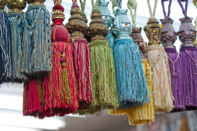 Multi colored tassels hanging for sale in market