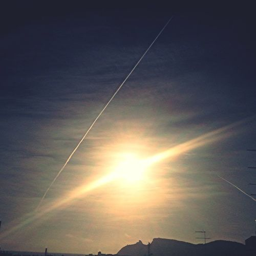 Lookingup The Sun And A Plane In The Sky