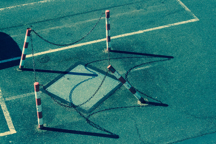 High Angle View Of Barricades Around Manhole On Road