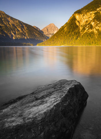 Long exposure of a mystic stone in a mountain lake. Mystic Beauty In Nature Colorful Black White Day Idyllic Lake Long Exposure Monochrome Mountain Mountain Range Nature No People Non-urban Scene Outdoors Reflection Reflections Remote Rock Rock - Object Scenics - Nature Sky Solid Tranquil Scene Tranquility Water