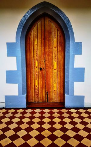 What's behind this door Eyeemabstract EyeEmNewHere EyeEm Best Shots EyeEm Bolt Wood Grain Doorknob Keyhole Diamond Pattern Diamond Pattern Floor Diamond Shapes Tiles Wooden Door Door Entrance Built Structure Doorway Architecture Entry Blue Indoors  No People Day