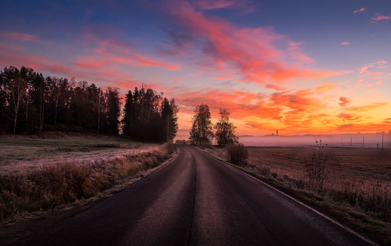 Road to sunrise Asphalt Autumn Beauty In Nature Cloud - Sky Colorful Sky Country Countryside Fall Fog Foggy Forest Landscape Morning Morning Light Nature No People Outdoors Road Scenics Sky Sunrise Sunset Tree