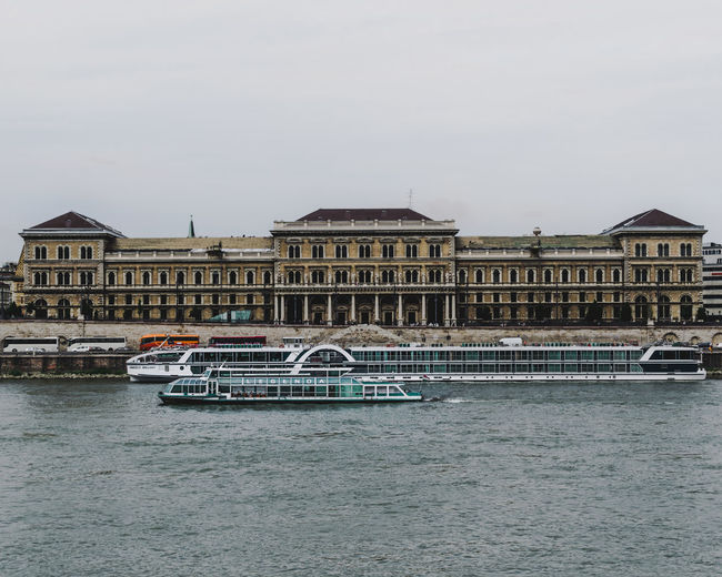 Budapest Riverside Architecture Building Building Exterior Built Structure City Corvinus Corvinusuniversity Craft Day Incidental People Mode Of Transportation Nature Nautical Vessel Outdoors Passenger Craft River Sky Transportation Travel Travel Destinations University Water Waterfront